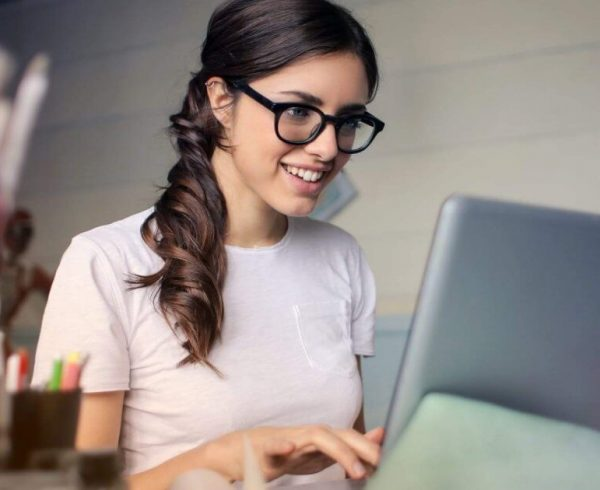 woman searching in laptop
